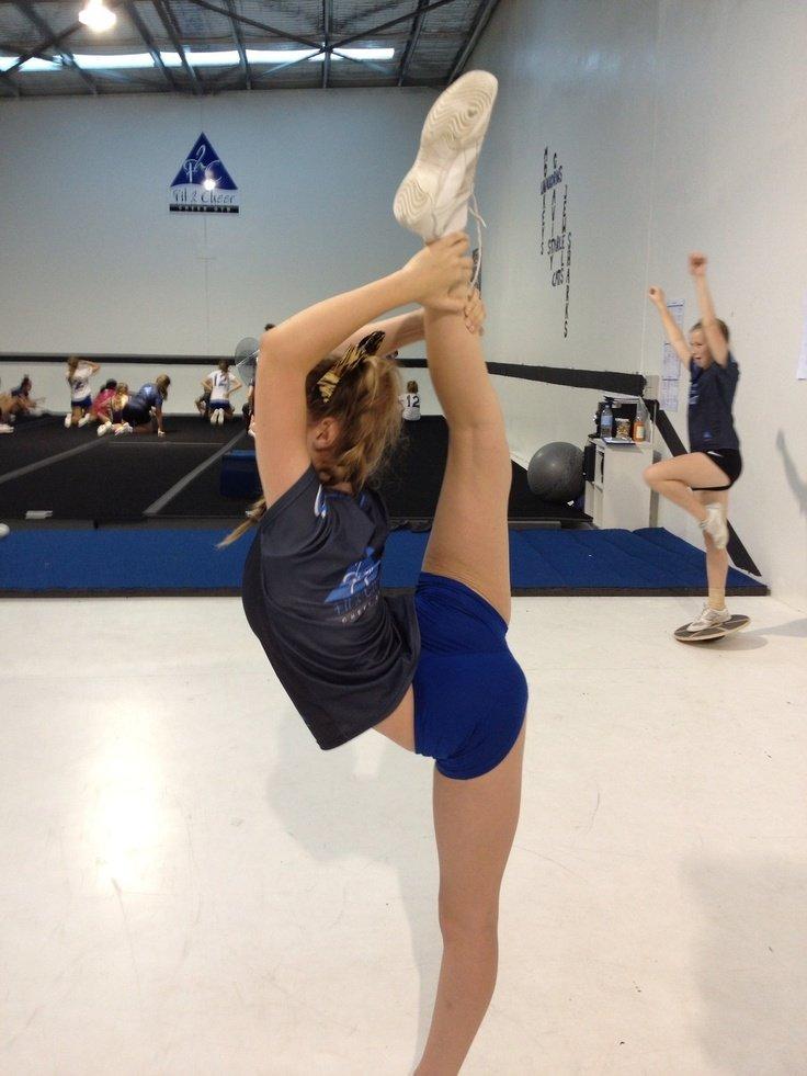 Girl performing needle pose